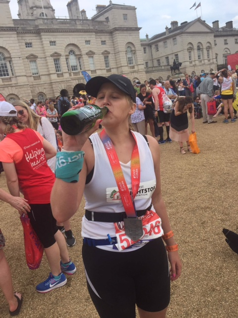 Faye celebrating with a beer!